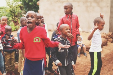 Tanzanian children dancing and singing songs
