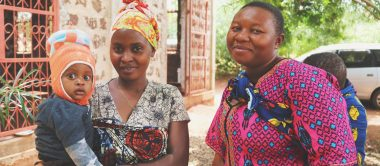 Two Tanzanian mothers who attended the with their children